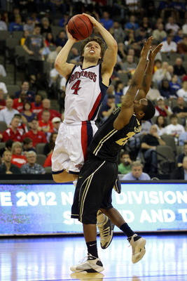 Dellavedova puts up a shot over Purdue's Lewis Jackson.