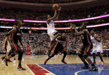 PHILADELPHIA, PA - APRIL 24: Lou Williams #23 of the Philadelphia 76ers puts up a shot in front of Joel Anthony #50 of the Miami Heat during the second half in Game Four of the Eastern Conference Quarterfinals in the 2011 NBA Playoffs at Wells Fargo Cente