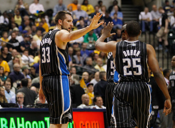 INDIANAPOLIS, IN - APRIL 30: Ryan Anderson #33 of the Orlando Magic high fives teammate Chris Duhon #25 after a play while playing Indiana Pacers in Game Two of the Eastern Conference Quarterfinals during the 2012 NBA Playoffs on April 30, 2012 at Bankers