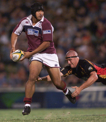 09 Mar 2002:  Toutai Kefu #8 of the Reds is tackled by Keith Robinson #5 of the Chiefs during the Super 12 Match between the Queensland Reds and the Chiefs played at Ballymore Stadium, Brisbane, Australia. DIGITAL IMAGE.  Mandatory Credit: Jonathan Wood/G