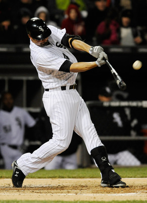 CHICAGO, IL - APRIL 27: Paul Konerko #14 of the Chicago White Sox hits a single in the third inning against the Boston Red Sox on April 27, 2012 at U.S. Cellular Field in Chicago, Illinois.  (Photo by David Banks/Getty Images)