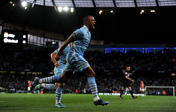 Vincent Kompany celebrates scoring v Man U