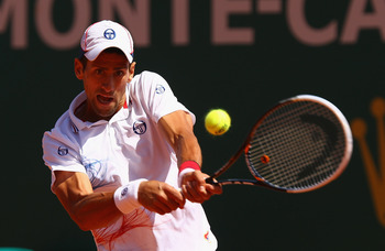 MONTE-CARLO, MONACO - APRIL 22:  L 22: Novak Djokovic of Serbia  in action against  Rafael Nadal of Spain in the final  during day eight of the ATP Monte Carlo Masters, at Monte-Carlo Sporting Club on April 22, 2012 in Monte-Carlo, Monaco..  (Photo by Cli