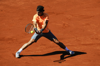 BARCELONA, SPAIN - APRIL 29:  Rafael Nadal of Spain returns the ball to David Ferrer of Spain during their Final match of the ATP 500 World Tour Barcelona Open Banco Sabadell 2012 tennis tournament at the Real Club de Tenis on April 29, 2012 in Barcelona,