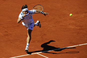BARCELONA, SPAIN - APRIL 29:  David Ferrer of Spain returns the ball to Rafael Nadal of Spain during their Final match of the ATP 500 World Tour Barcelona Open Banco Sabadell 2012 tennis tournament at the Real Club de Tenis on April 29, 2012 in Barcelona,