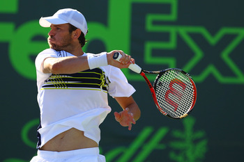 KEY BISCAYNE, FL - MARCH 29:  Mardy Fish of the USA in action against Juan Monaco of Argentina during Day 11 at Crandon Park Tennis Center at the Sony Ericsson Open on March 29, 2012 in Key Biscayne, Florida.  (Photo by Al Bello/Getty Images)