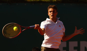 MONTE-CARLO, MONACO - APRIL 21:  21:  Gilles Simon of France plays a forehand against Rafael Nadal of Spain in their semi-final during day seven of the ATP Monte Carlo Masters, at Monte-Carlo Sporting Club  on April 21, 2012 in Monte-Carlo, Monaco.  (Phot
