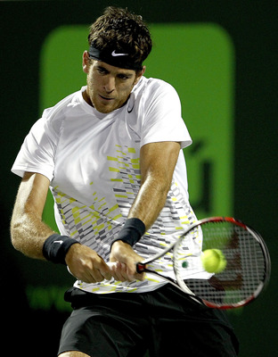 KEY BISCAYNE, FL - MARCH 27:  Juan Martin Del Potro of Argentina returns a shot to David Ferrer of Spain during the Sony Ericsson Open at the Crandon Park Tennis Center on March 27, 2012 in Key Biscayne, Florida.  (Photo by Matthew Stockman/Getty Images)