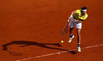 MONTE-CARLO, MONACO - APRIL 17:  17:  17:  17:  17:  17:  17:  Robin Haase of Holland plays a forehand in his match against Juan Monaco of Argentina  during day three of the ATP Monte Carlo Masters on April 17, 2012 in Monte-Carlo, Monaco.  (Photo by Juli