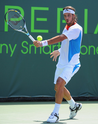 KEY BISCAYNE, FL - MARCH 24:  Feliciano Lopez of Spain in action during his match with Albert Ramos of Spain during day 6 of the Sony Ericsson Open at Crandon Park Tennis Center on March 24, 2012 in Key Biscayne, Florida.  (Photo by Michael Regan/Getty Im