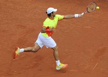 BARCELONA, SPAIN - APRIL 28:  Fernando Verdasco of Spain returns the ball against Rafael Nadal of Spain during their Semi-final match of the ATP 500 World Tour Barcelona Open Banco Sabadell 2012 tennis tournament at the Real Club de Tenison April 28, 2012