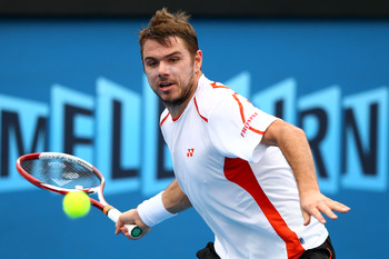 MELBOURNE, AUSTRALIA - JANUARY 20:  Stanislas Wawrinka of Switzerland plays a forehand in his third round match against Nicolas Almagro of Spain during day five of the 2012 Australian Open at Melbourne Park on January 20, 2012 in Melbourne, Australia.  (P