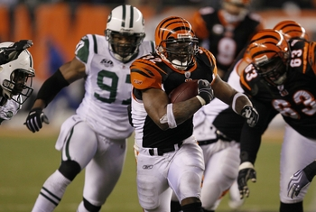 Free agent running back Cedric Benson runs from Jets defender Calvin Pace during 2010 playoff game.