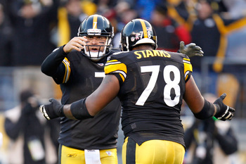 Free agent lineman Max Starks about to embrace Steelers quarterback Ben Roethlisberger last season.