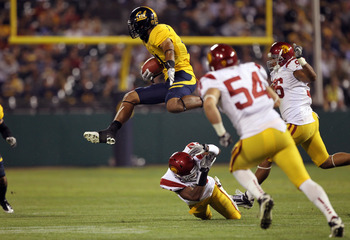 SAN FRANCISCO, CA - OCTOBER 13:  Keenan Allen #21 of the California Golden Bears leaps over Isiah Wiley #14 of the USC Trojans at AT&T Park on October 13, 2011 in San Francisco, California.  (Photo by Ezra Shaw/Getty Images)