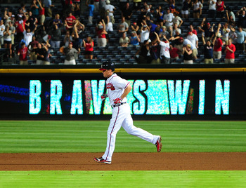 Chipper trots the bases after his game-winning blast.