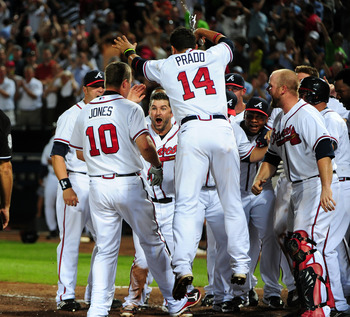 The Braves celebrate a game-winner, as they always do when Chipper steps it up.