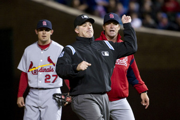 "Umpire Tim Welke ""christens"" the Cards new manager."