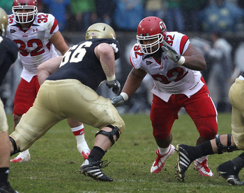 SOUTH BEND, IN - NOVEMBER 13: Star Lotulelei #92 of the Utah Utes rushes against Chris Watt #66 of the Notre Dame Fighting Irish at Notre Dame Stadium on November 13, 2010 in South Bend, Indiana. Notre Dame defeated Utah 28-3. (Photo by Jonathan Daniel/Ge