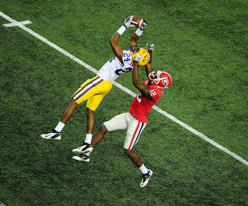 ATLANTA, GA - DECEMBER 3: Tharold Simon #24 of the LSU Tigers intercepts a pass against Tavarres King #12 of the Georgia Bulldogs during the SEC Championship Game at the Georgia Dome on December 3, 2011 in Atlanta, Georgia. Photo by Scott Cunningham/Getty