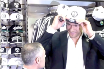 Brook Lopez is the first NBA player in black and white Nets swag ...with Nets CEO Brett Yormark (BrooklynFans.com)