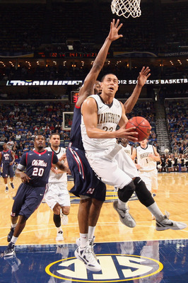 NEW ORLEANS, LA - MARCH 10:  John Jenkins #23 of the Vanderbilt Commodores makes a layup against the Mississippi Rebels during the Semifinal round of the SEC Men's Basketball Tournament at the New Orleans Arena on March 10, 2012 in New Orleans, Louisiana.