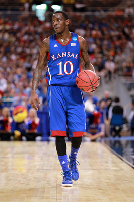 ST LOUIS, MO - MARCH 25:  Tyshawn Taylor #10 of the Kansas Jayhawks looks on against the North Carolina Tar Heels during the 2012 NCAA Men's Basketball Midwest Regional Final at Edward Jones Dome on March 25, 2012 in St Louis, Missouri. Kansas won 80-67. 