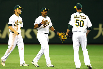 Balfour with Yoenis Cespedes (pictured center, 27 years old) and Josh Reddick (25)