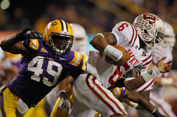 BATON ROUGE, LA - NOVEMBER 12:  Kawaun Jakes #6 of the Western Kentucky Hilltoppers is tackled by Barkevious Mingo #49 of the Louisiana State University Tigers at Tiger Stadium on November 12, 2011 in Baton Rouge, Louisiana. The Tigers defeated the Hillto