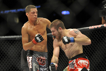 Diaz (L) battles with Jim Miller (Josh Hedges/Zuffa, LLC)