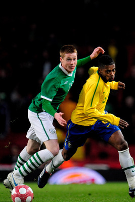 LONDON, ENGLAND - MARCH 02:  Michel Bastos of Brasil battles with James McCarthy of Ireland during the International Friendly match between Republic of Ireland and Brazil played at Emirates Stadium on March 2, 2010 in London, England.  (Photo by Jamie McD