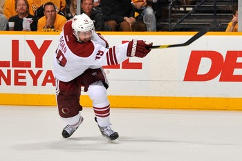 Coyotes captain Shane Doan fires a puck at the net.