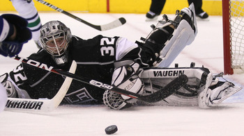 Jonathan Quick spots a loose puck around the net.