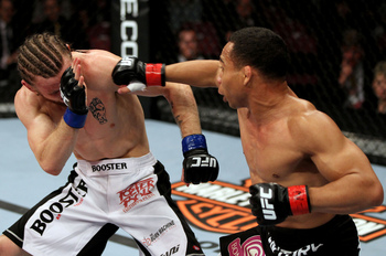 John Dodson (R) punches Timothy Elliott (L) during their Flyweight bout at Izod Center on May 5, 2012, in East Rutherford, New Jersey. (Photo by Josh Hedges/Zuffa LLC/Zuffa LLC via Getty Images)