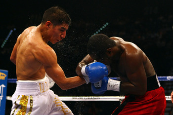 LAS VEGAS, NV - MAY 05:  (L-R) Jessie Vargas connects with a right to the face of Steve Forbes during their welterweight fight at the MGM Grand Garden Arena on May 5, 2012 in Las Vegas, Nevada.  (Photo by Al Bello/Getty Images)