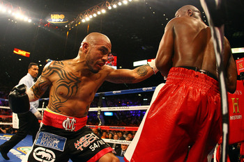 LAS VEGAS, NV - MAY 05:  (L-R) Miguel Cotto throws a left punch at Floyd Mayweather Jr. during their WBA super welterweight title fight at the MGM Grand Garden Arena on May 5, 2012 in Las Vegas, Nevada.  (Photo by Al Bello/Getty Images)