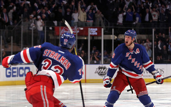 NEW YORK, NY - MAY 07:  Marc Staal #18 of the New York Rangers celebrates with teammate Anton Stralman #32 after scoring the winning a goal in overtime against Braden Holtby #70 of the Washington Capitals in Game Five of the Eastern Conference Semifinals
