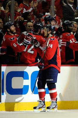 WASHINGTON, DC - MAY 02:  John Carlson #74 of the Washington Capitals celebrates after scoring a goal against the New York Rangers in the second period in Game Three of the Eastern Conference Semifinals during the 2012 NHL Stanley Cup Playoffs at the Veri