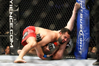 MONTREAL- MAY 8: Johny Hendricks (top) holds on to TJ Grant in their welterweight bout at UFC 113 at Bell Centre on May 8, 2010 in Montreal, Quebec, Canada.  (Photo by Richard Wolowicz/Getty Images)