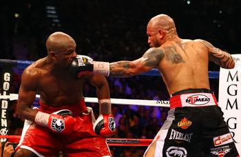 Floyd Mayweather tasting a straight left from Miguel Cotto