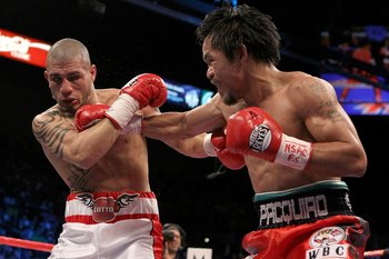 Miguel Cotto being countered by Manny Pacquiao