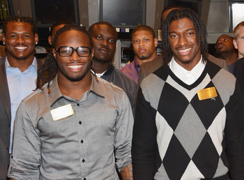 Trent Richardson and Washington Redskins quarterback Robert Griffin III (with Dont'a Hightower photo-bombing in the background).