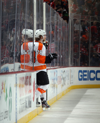 Philadelphia Flyers F Claude Giroux in the penalty box.