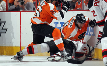 Zac Rinaldo and Sean Couturier sandwiches Dainus Zubrus.
