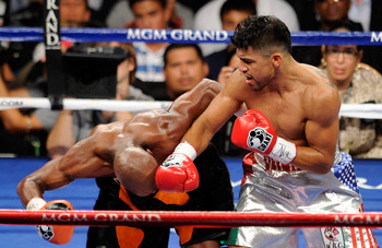 Victor Ortiz swinging at a bent over Floyd Mayweather