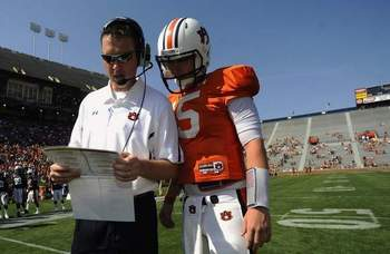 Offensive Coordinator Scot Loeffler checks calls with QB Clint Moseley during 2012 A-Day/ Photo by Todd Van Emst