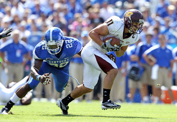 LEXINGTON, KY - SEPTEMBER 10:  Cody Wilson #11 of the Central Michigan Chippewas runs with the ball while defended by Danny Trevathan #22 of the Kentucky Wildcats during the game at Commonwealth Stadium on September 10, 2011 in Lexington, Kentucky.  (Phot