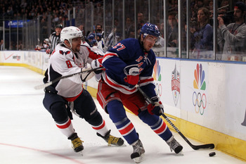 Ryan McDonagh (right) battles with Alex Ovechkin.