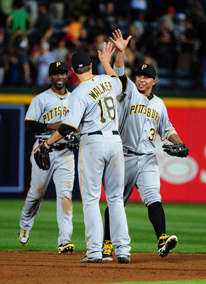Pirates' outfielders Andrew McCutchen (left) and José Tabata (right) greet second baseman Neil Walker after a victory.