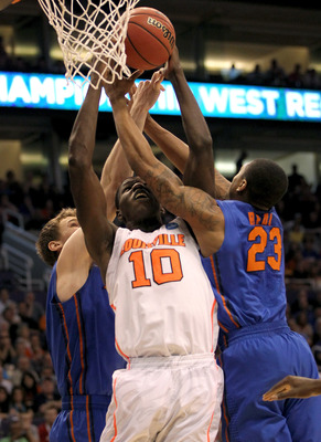 Dieng fights through a maze of arms against Florida.
